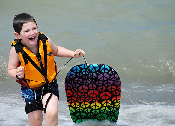 Picture of school child enjoying surfing lesson Isle of Wight